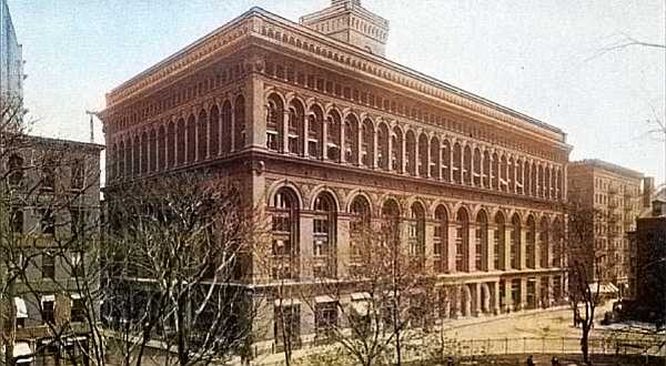 The New York Produce Exchange at Bowling Green was the leading export market for wheat, cotton-seed oil, flour and lard. It gave its name to a form time charter party contract. The old building was considered an architectural masterpiece in its time, featuring an enormous skylighted hall. It was torn down in 1959.